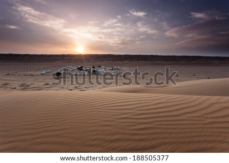 Sunset in the desert - stock photo