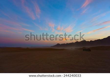 sunset in the desert - stock photo