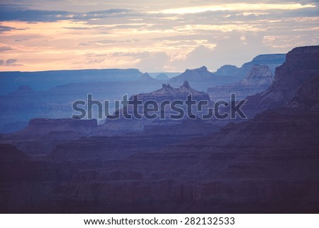 Sunset in the Grand Canyon national park, USA. Light going through the clouds.  - stock photo
