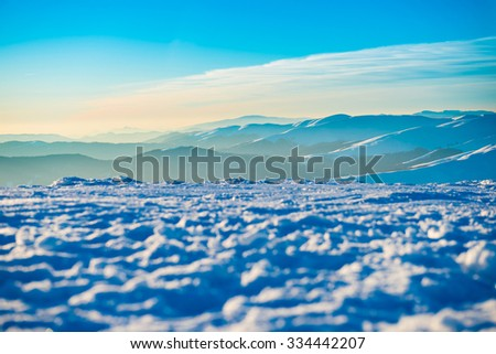 Sunset in the mountains. Winter landscape with white snow - stock photo