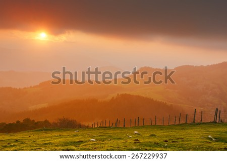 sunset in the mountains with warm light - stock photo