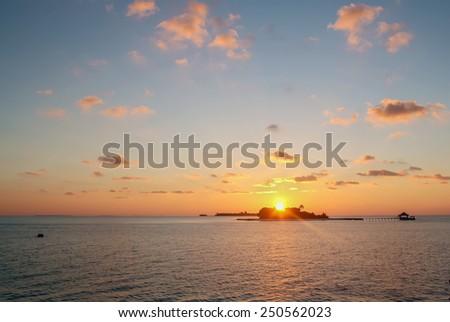 sunset in the ocean near Maldives - stock photo