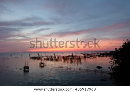Sunset in the sea in thailand - stock photo