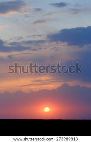 Sunset in the steppe near the salt lake Lopuhovatoe, Rostov region, Russia. - stock photo