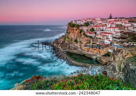 Sunset in the town Azenhas do Mar. With natural pool. - stock photo
