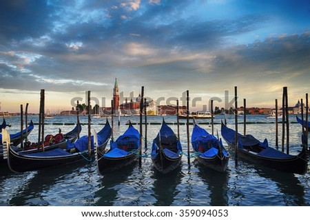 Sunset in Venice. Gondolas moored on Grand Canal and San Giorgio Maggiore church in the background. Venice, Italy, Europe. - stock photo