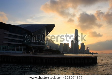 Sunset in Victoria Harbor, silhouette of Hong Kong. - stock photo