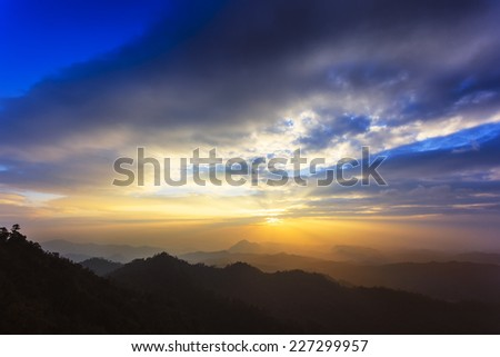 Sunset landscape on top of mountain view - stock photo