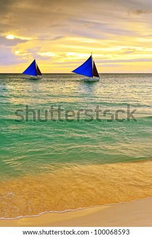 Sunset  landscape. Sailboat on coast of Boracay island. - stock photo