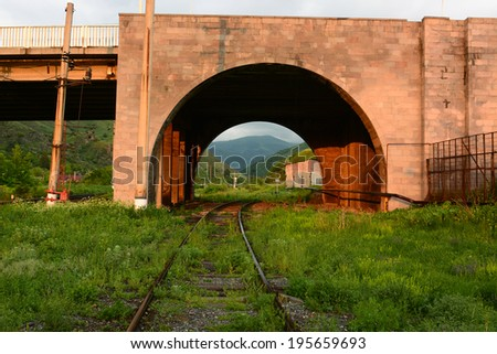 Sunset landscape with railroad bridge  - stock photo