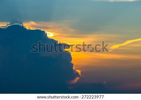 Sunset light Behind the clouds - stock photo