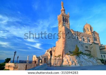 Sunset light illuminates the Church Notre Dame de la Garde, Marseille, France - stock photo