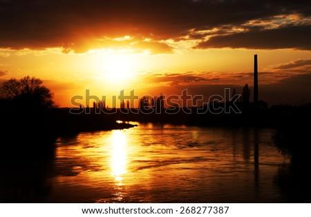 Sunset light over Mures river, Arad, Romania - stock photo