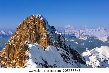"Sunset light view on a mountain peak in French Alps, as seen from a top of Courchevel, one of the several ski resorts forming ""The Three Valleys"" the famously largest ski domain in the world - stock photo"