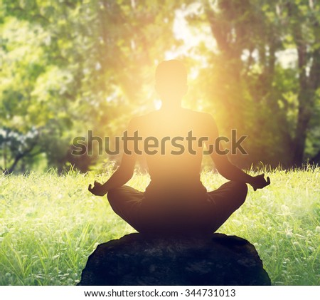 Sunset meditation in forest - stock photo