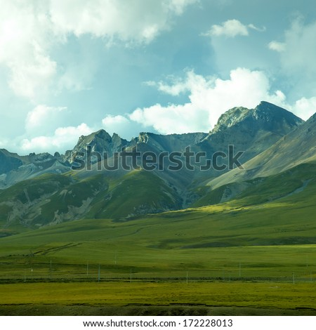 Sunset mountain grasslands - stock photo