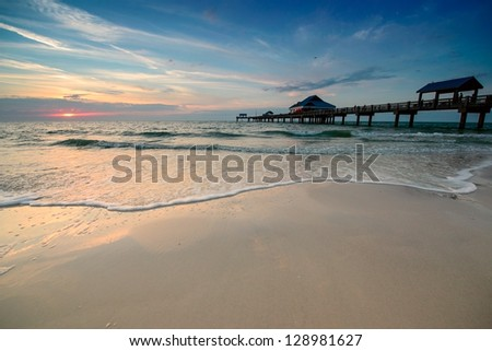 Sunset near Pier 60 on a Clearwater Beach, Florida, USA. - stock photo