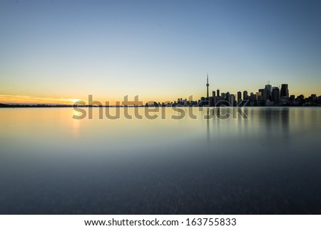 Sunset next to downtown Toronto during early winter time - stock photo