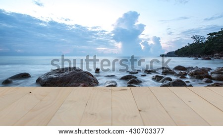 SUNSET OF CORAL REEF COASTLINE THAILAND.and table Can use for product display - stock photo