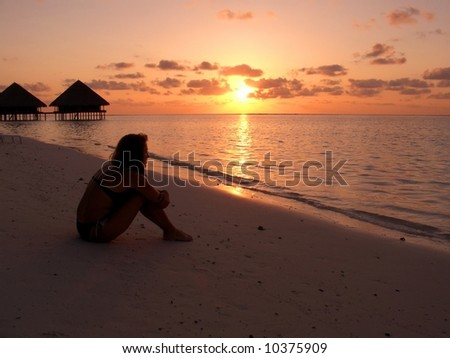 Sunset on a beach - stock photo