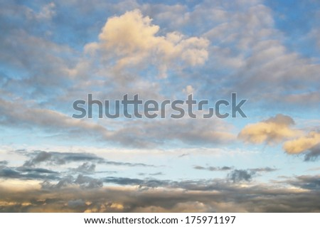 Sunset on a cloudy sky. - stock photo