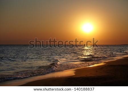 Sunset on a common beach, landscape photo. - stock photo