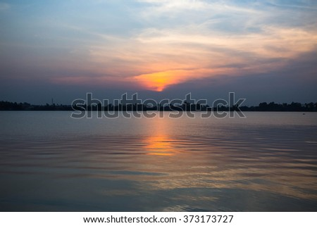 Sunset on a lake for background  - stock photo