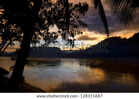 sunset on a river - stock photo
