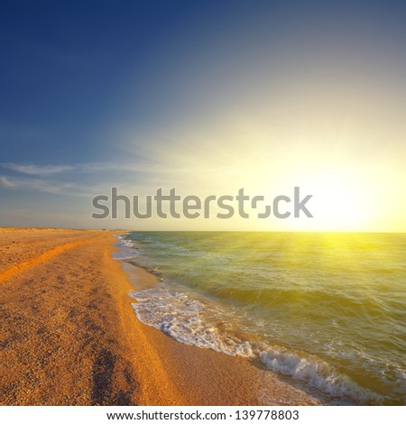 sunset on a sea coast - stock photo