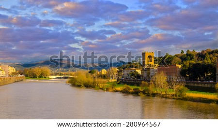 Sunset on Arno river in Florence (Firenze), Tuscany, Italy - stock photo