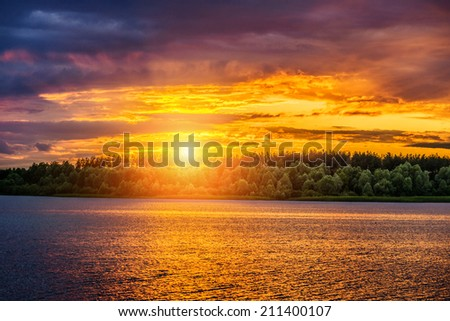Sunset on background of river in central Russia. - stock photo