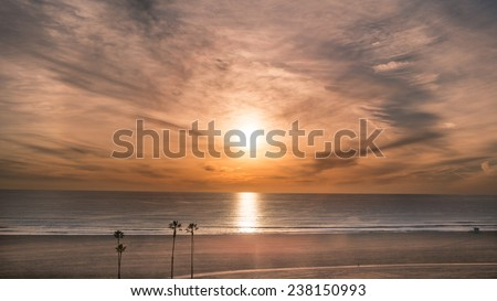 Sunset on Beach with Pacific Ocean View on West Coast in Santa Monica with Palm Trees and Sand in California - stock photo