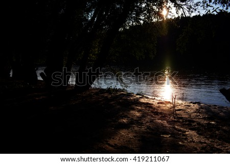 Sunset on Danube river shore - stock photo