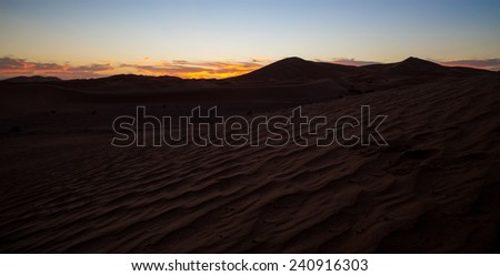 Sunset on dunes and desert - stock photo