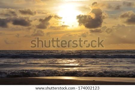Sunset on Kuta beach in Bali. Indonesia - stock photo