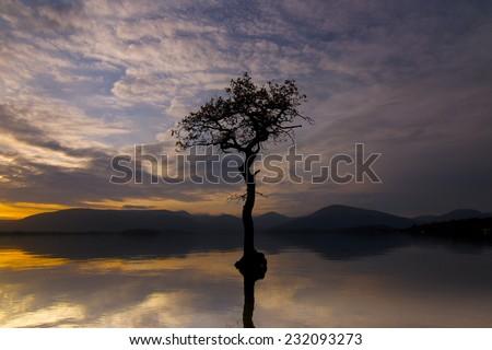 Sunset on Loch Lomond - stock photo