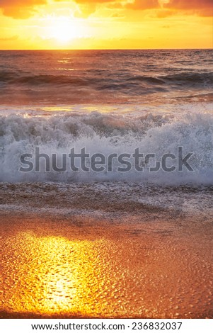 Sunset on Mai Khao beach in Phuket, Thailand - stock photo