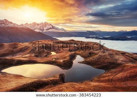 Sunset on mountain lake Koruldi. Upper Svaneti, Georgia, Europe. Caucasus mountains. - stock photo