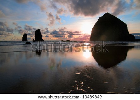 Sunset on Oregon Beach at Haystack Rock - stock photo