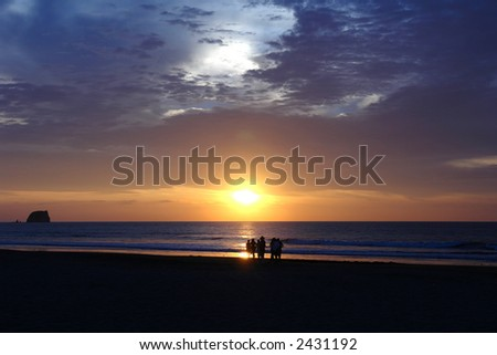 sunset on pacific ocean. ecuador. south america - stock photo