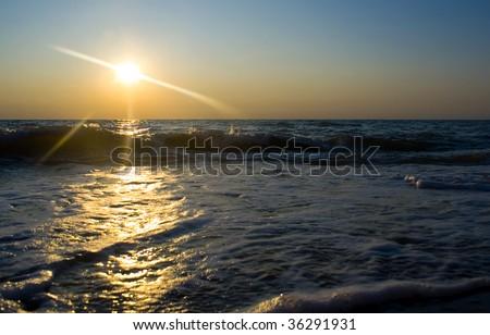 Sunset on sea beach landscape background - stock photo