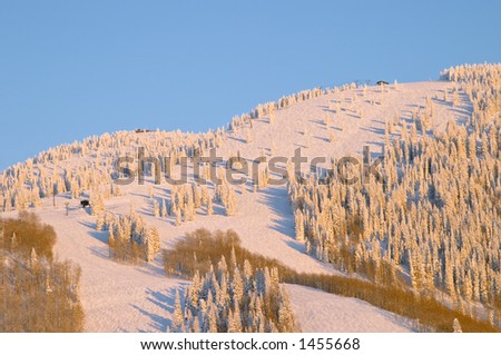 Sunset on ski slopes at winter, Steamboat ski resort, Colorado, United States - stock photo