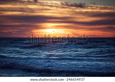 Sunset on the Baltic Sea at summer time - stock photo