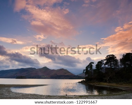 Sunset on the banks of Derwent Water - stock photo
