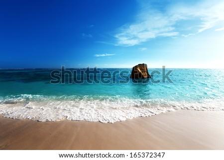 sunset on the beach, Anse Source d'Argent, La Digue island, Seyshelles - stock photo