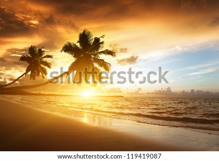 sunset on the beach of Caribbean sea, Dominican Republic  - stock photo