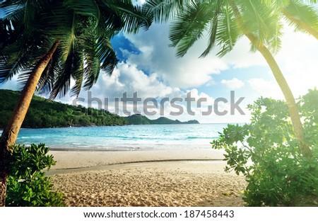 sunset on the beach Takamaka, Mahe island, Seychelles - stock photo