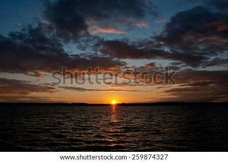 Sunset on the beach with beautiful sky - stock photo