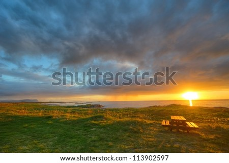 Sunset on the coast of Andoya in Norway - stock photo