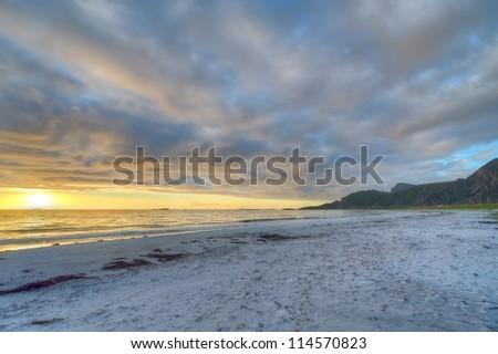 Sunset on the coast of Andoya in Norway - stock photo